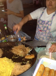 A lady making our pad thai