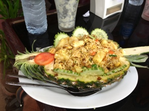 Rice mixture of chicken veggies and pineapple. Served beautifully.